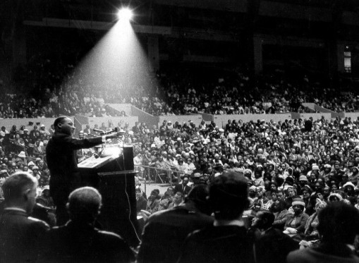 """I've Been to the Mountaintop"" Memphis, Tennessee; April 3, 1968 Making his final speech before his assassination on the next day, King primarily addressed the Memphis Sanitation Strike. Photo Credit: http://www.juvenile-in-justice.com/wp-content/uploads/2013/04/MLK-Speech.jpg"