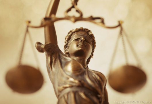 Lady Justice holding her iconic scales. http://cmsny.org/wp-content/uploads/lady-liberty-scales-of-justice-h-1000.jpg