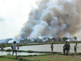 "A Rohingya Village being burned in Arakan State Photo Credit: ""All You Can Do Is Pray"" - Human Rights Watch"