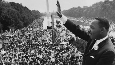 Martin Luther King Jr. acknowledging the crowd at the Lincoln Memorial  (Image courtesy of http://abcnews.go.com/US/things-make-dream-famous-speeches-history/story?id=20068795)