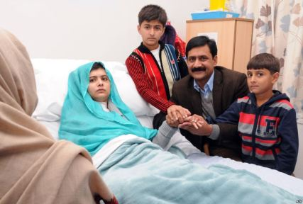 Malala and her family during her recovery. Her mother, who prefers to not be photographed can be seen from behind on the bottom left corner.