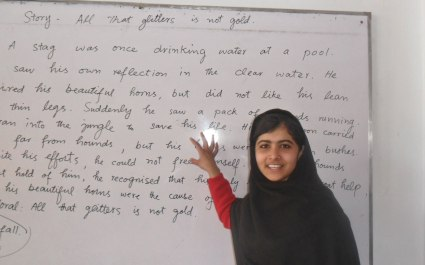 "Malala at school reading a story: ""All That Glitters Is Not Gold."""