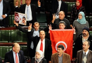Members of the Tunisian National Constituent Assembly jubilate after the adoption of a new constitution on January 26, 2014.